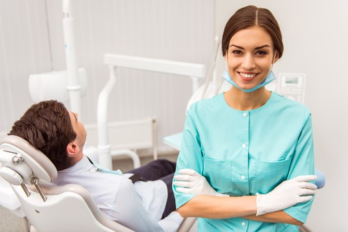 dental professional with patient in dental chair